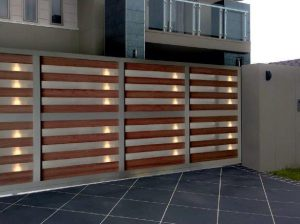 A large sliding gate of wood and aluminium.